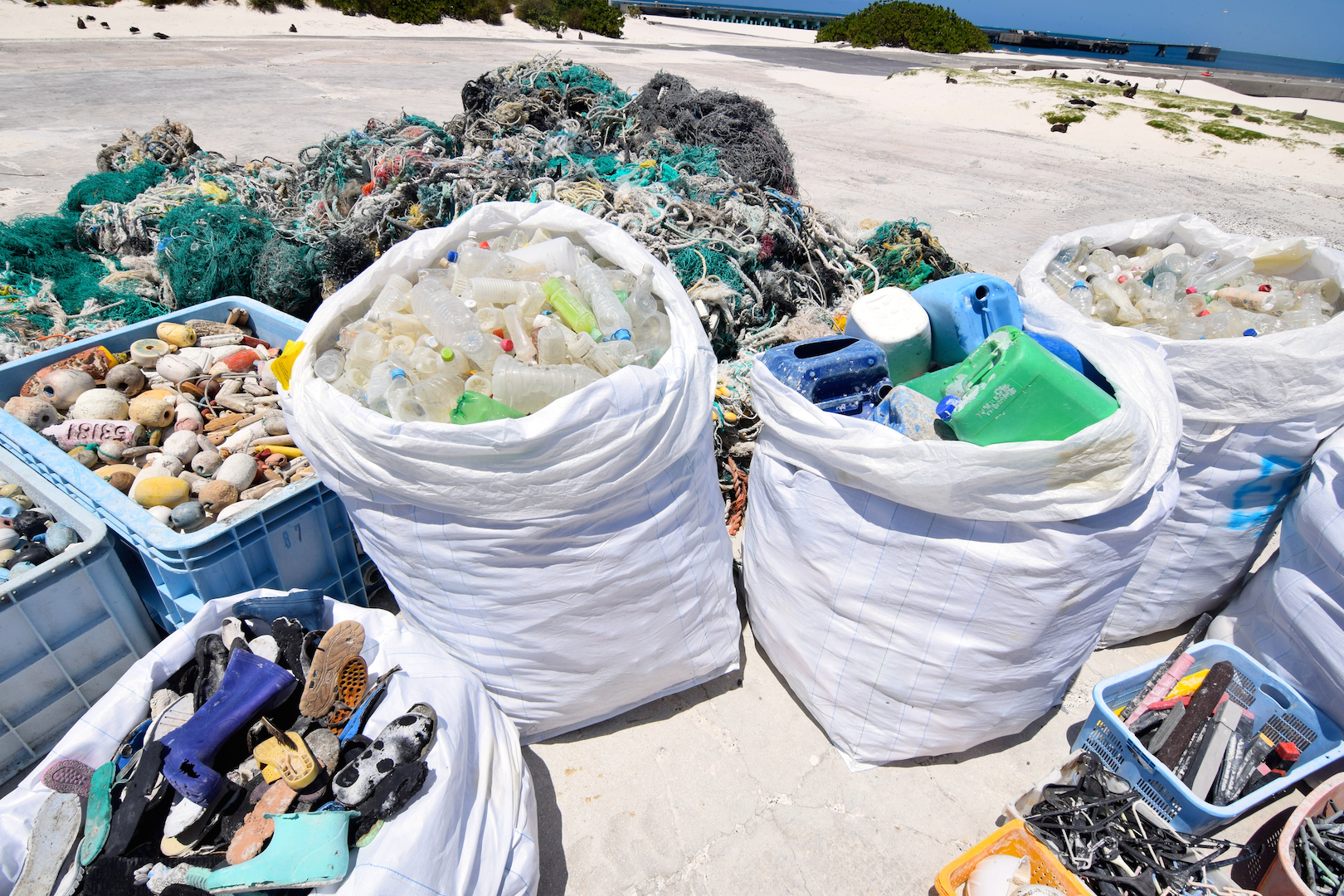 Midway, Atoll, Island, Northwestern, Hawaiian, beach, clean up, marine, debris, plastic, nets, floats, fishing, removal, bottles, shoes, hangers,
